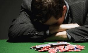 depressed man at casino table problem gambling gambling addiction