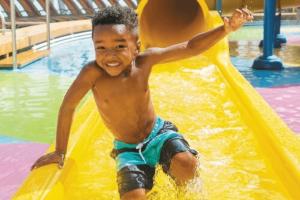 child on water slide casino activities
