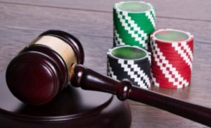 casino chips with judges gavel gambling law and gambling bill