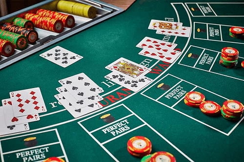 blackjack table with chips and cards