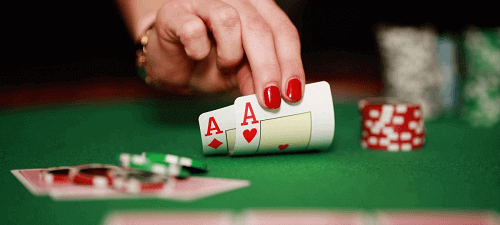 casino table game with two red aces and chips