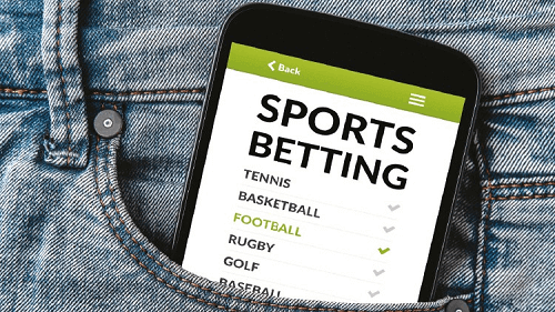 cellphone with best sports betting site in the pocket of a jean