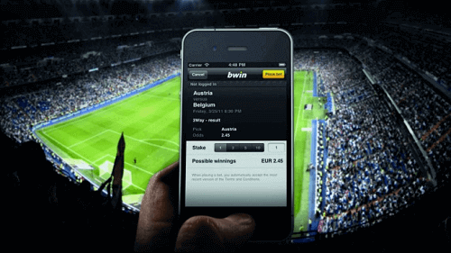 cellphone showing live betting app at a stadium