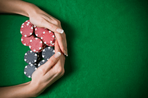 hands pulling casino chips best pay out casinos